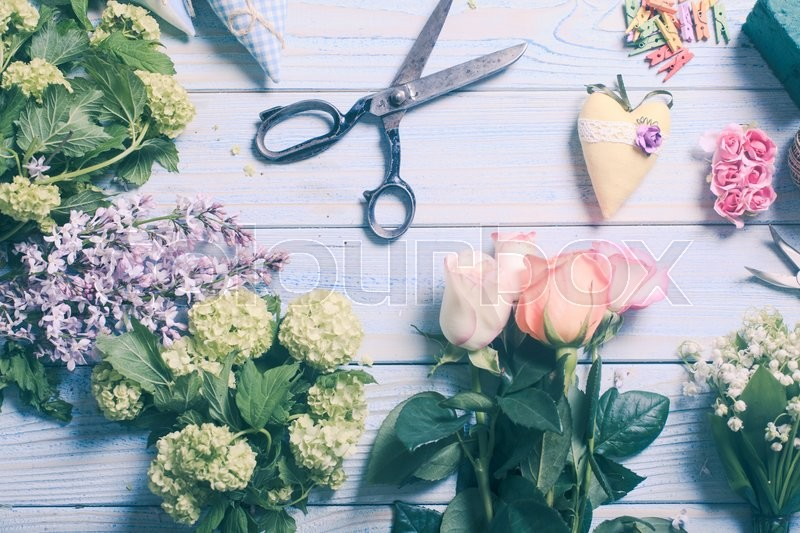 Stock image of 'Preparation of flower bouquet, top view of florist workplace with copy space'