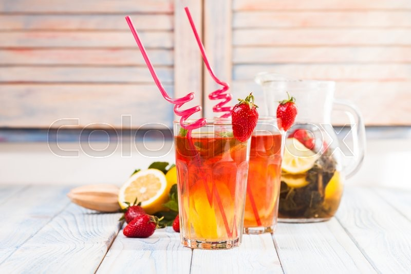 Stock image of 'Lemonade with a strawberry, lemon and mint'