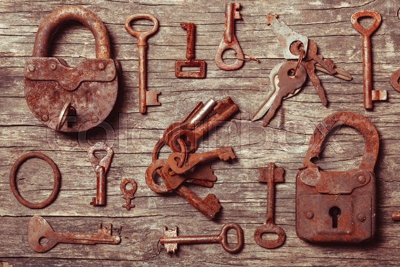 Stock image of 'old keys locks over vintage wooden table'
