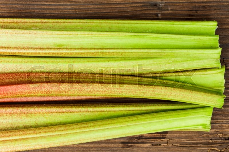 Stock image of 'rhubarb close up on the wooden background'