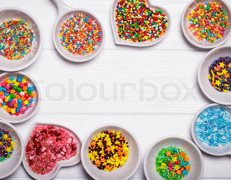 Stock image of 'Various color sprinkles in a white bowls'