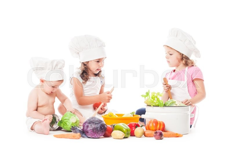 Stock image of 'Three kids play with vegatables. Little chefs isolated on white'