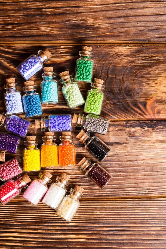 Stock image of 'Beads in the vintage mini glass bottles'