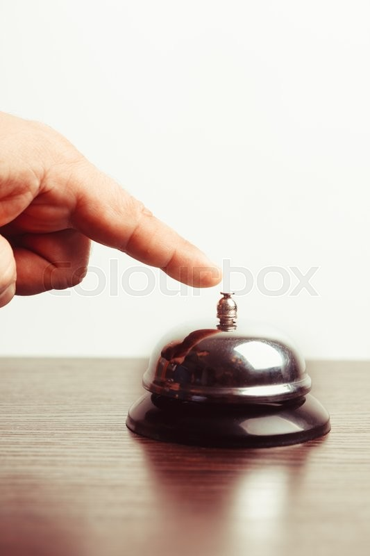 Stock image of 'Close-up finger that presses of the service bell ring'