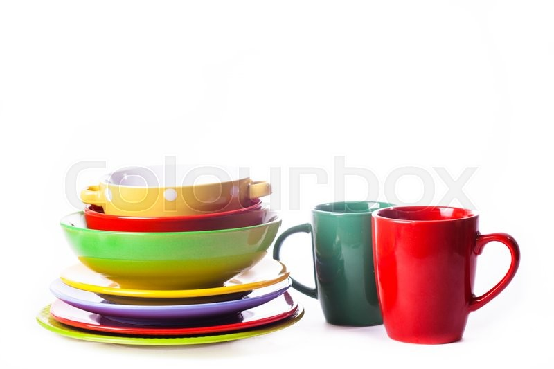 Stock image of 'Big stack of different colors mugs and plate on white background, one above the another'