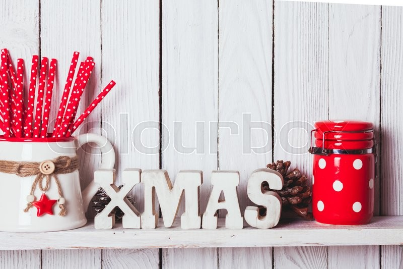 Stock image of 'Christmas decor on the shelf - wooden letters XMAS in the kitchen'