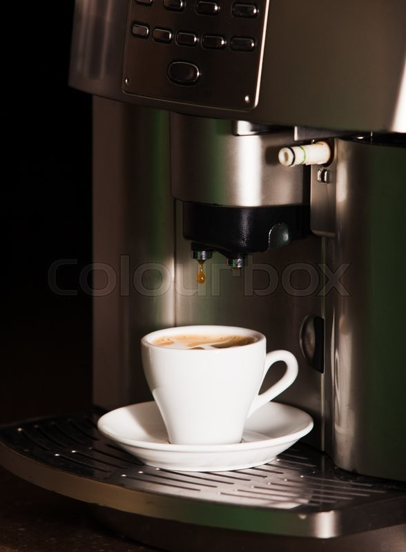 Stock image of 'Coffee machine brewing a coffee espresso in home'