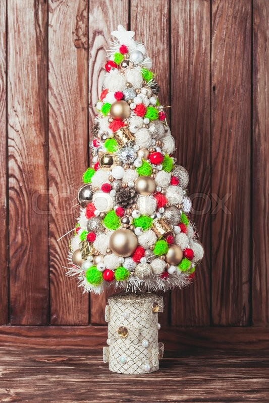 Stock image of 'Handmade Christmas tree over wooden background, copy space'