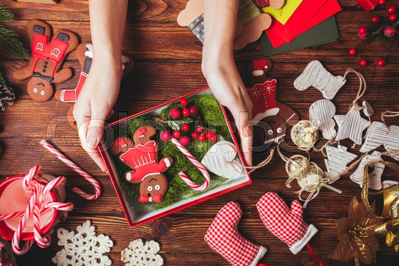 Preparation a Christmas gift box for friends | Stock Photo | Colourbox