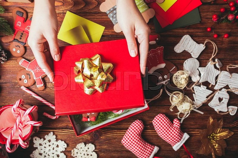 Stock image of 'Preparation a Christmas gift box for friends'