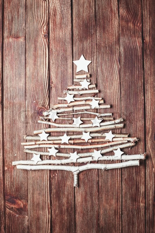 Stock image of 'Birch branches and white stars in a shape of christmas tree'
