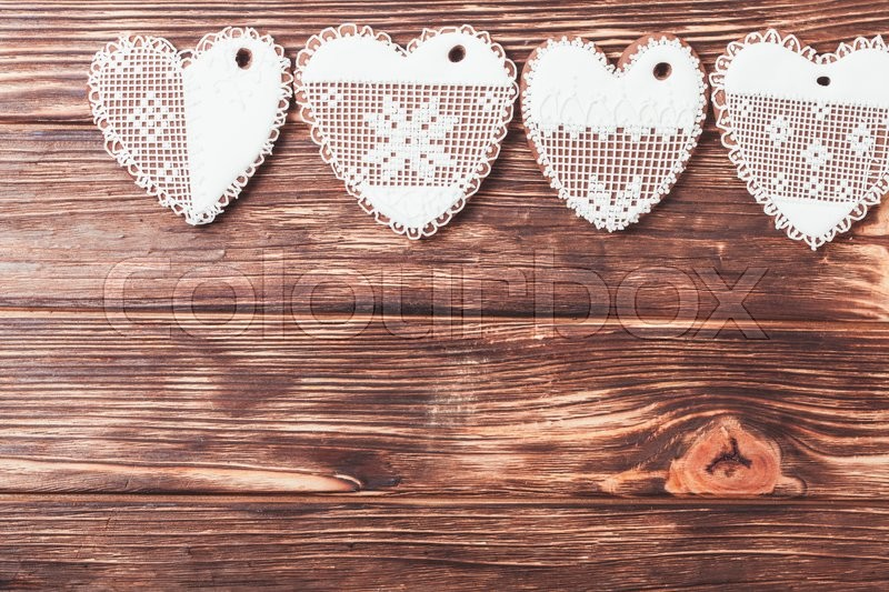 Stock image of 'Gingerbread cookies in shape of heart with icing on a wooden background'