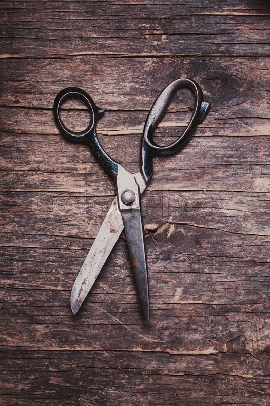 Stock image of 'Retro vintage scissors on the wooden background'