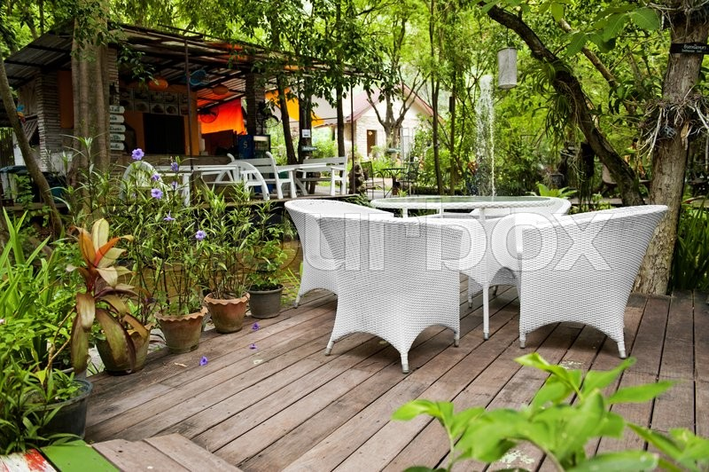 Stock image of 'White chair in the garden'