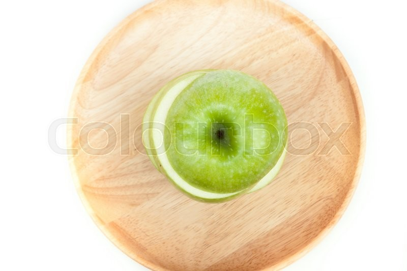 Stock image of 'Sliced green apple on wooden plate on white background'