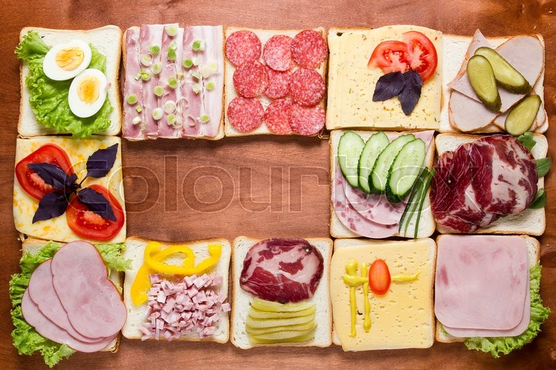 Stock image of 'Still life of sandwiches on a wooden background'