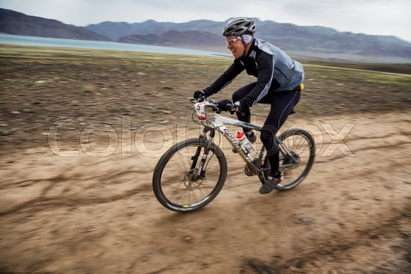 Stock image of 'ALMATY, KAZAKHSTAN - MAY 02, 2016: M.Kosyr (N5) in action at Adventure mountain bike cross-country competition in mountains \