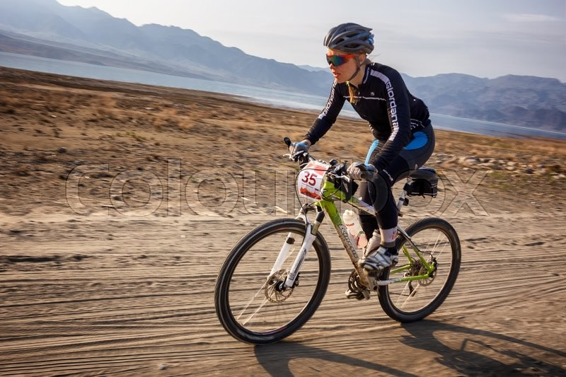Stock image of 'ALMATY, KAZAKHSTAN - MAY 01, 2016: T.Sherbanenko (N35) in action at Adventure mountain bike cross-country competition in mountains \