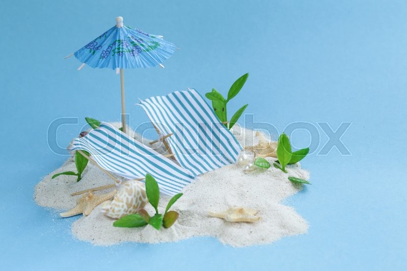 Stock image of 'Travel vacation concept - sand island beach with sunbeds'