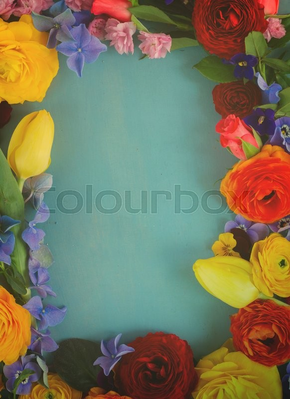 Stock image of 'Flowers festive frame with copy space on blue wooden table, retro toned '