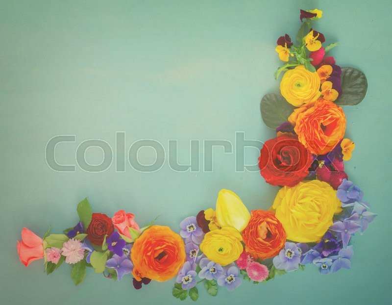 Stock image of 'Flowers festive composition on blue wooden table with copy space, retro toned'