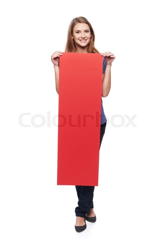 Stock image of 'Full length young woman holding vertically red strip blank cardboard, over white background'