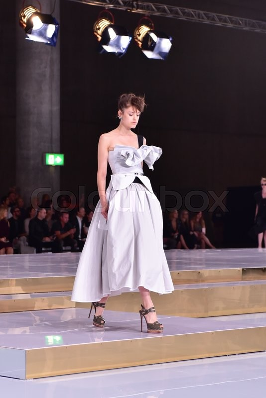 Editorial image of 'SYDNEY AUSTRALIA - 15 May 2016: Toni Maticevski female evening and red carpet dresses clothing collection fashion show runway at Mercedes Benz Fashion Week in The Cutaway Barangaroo Reserve Sydney Australia'