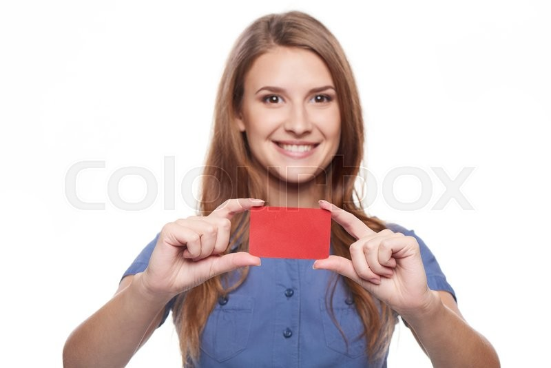 Stock image of 'Confident smiling business woman female showing blank credit card, over white background. Shallow depth of field, focus on credit card.'