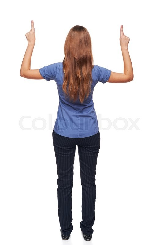 Stock image of 'Back view of young casual female in full length pointing at blank copy space with both hands, isolated on white'