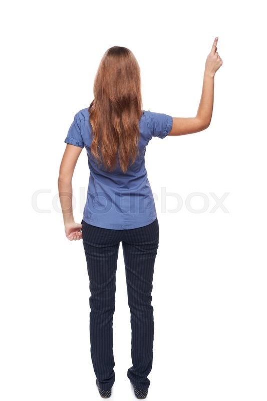 Stock image of 'Back view of young casual female in full length pointing at blank copy space, isolated on white'