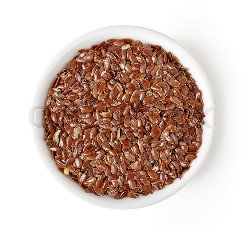 Stock image of 'Bowl of flax seeds isolated on white background, top view'