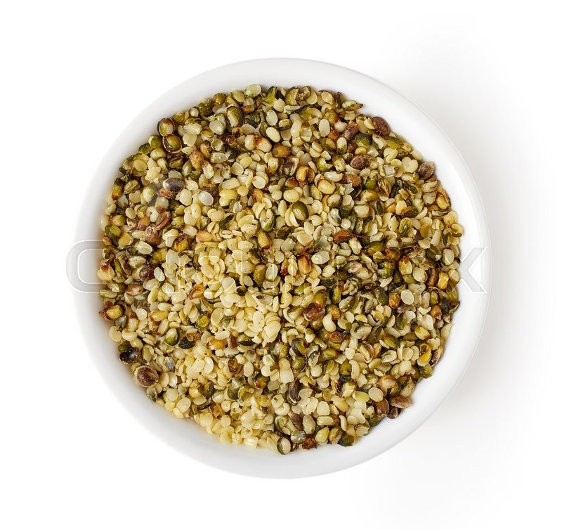 Stock image of 'Bowl of hemp seeds isolated on white background, top view'