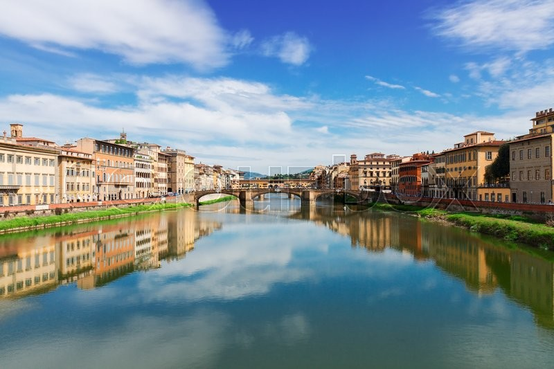 Stock image of 'famous Triniti and  Ponte Vecchio bridges reflecting in river Arno at summer day, Florence, Italy'