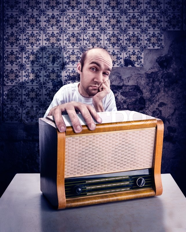 Stock image of 'Sad man with vintage radio on the table'