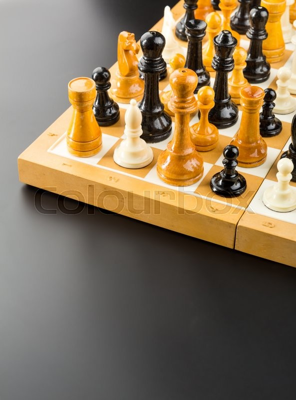 Stock image of 'Many different chess figures standing on the board'