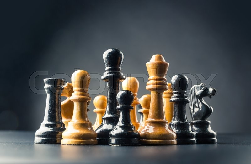 Stock image of 'Various chess figures on the table over black'