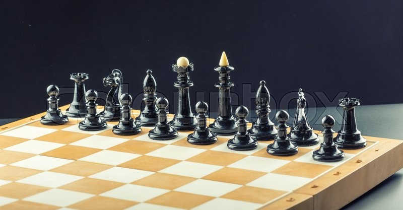 Stock image of 'Black chess figures on the board ready to fight'