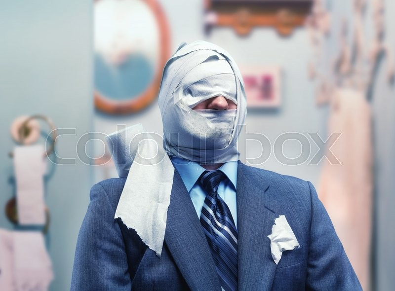 Stock image of 'Businessman in toilet paper in the bathroom'