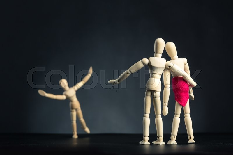 Stock image of 'Family of wooden figures, child having fun'