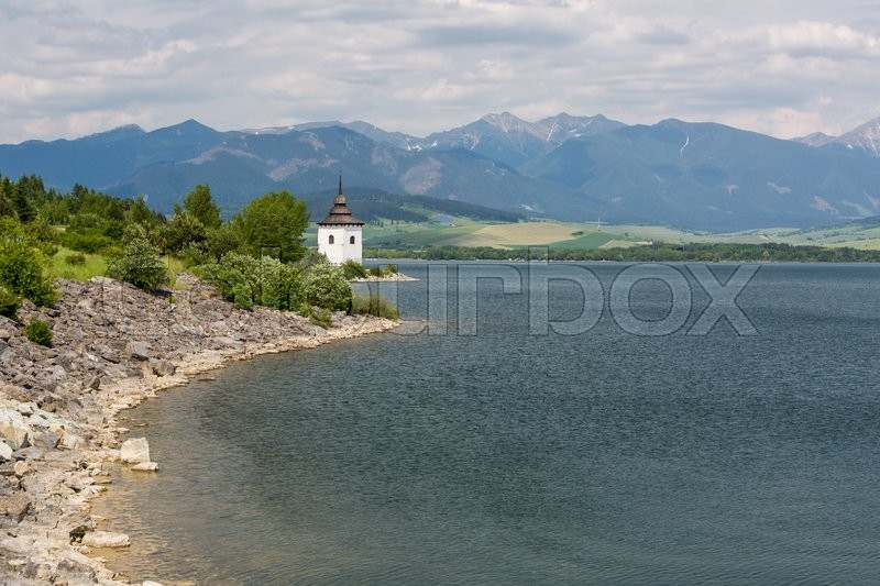 Stock image of 'View of a gothic church Havranok at Lake Liptovska Mara, Slovakia on June 3, 2015'