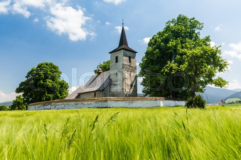 Stock image of 'View of a gothic church in Ludrova village near Ruzomberok in Slovakia, summer 2015'