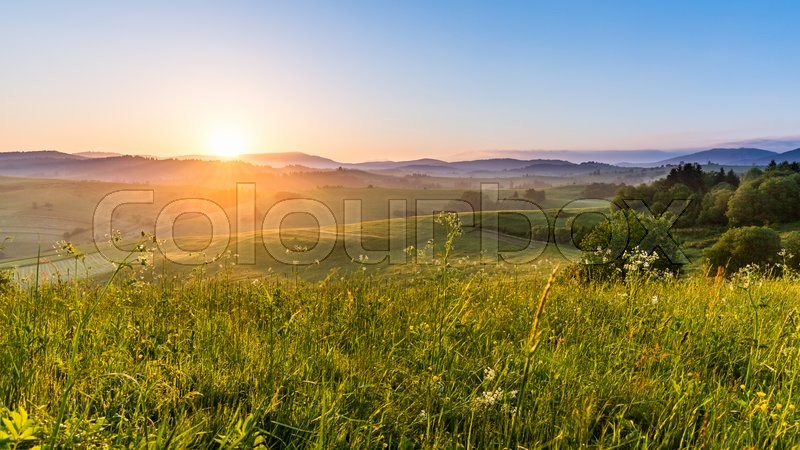 Stock image of 'Views of fields and hills at sunrise near Dolny Kubin in Slovakia in summer 2015'