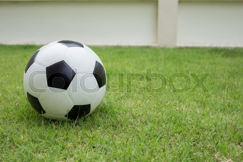 Stock image of 'soccer ball on green grass sport game background'