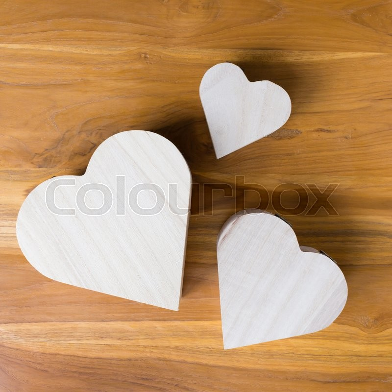 Stock image of 'Wood box shaped heart on brown wooden background'