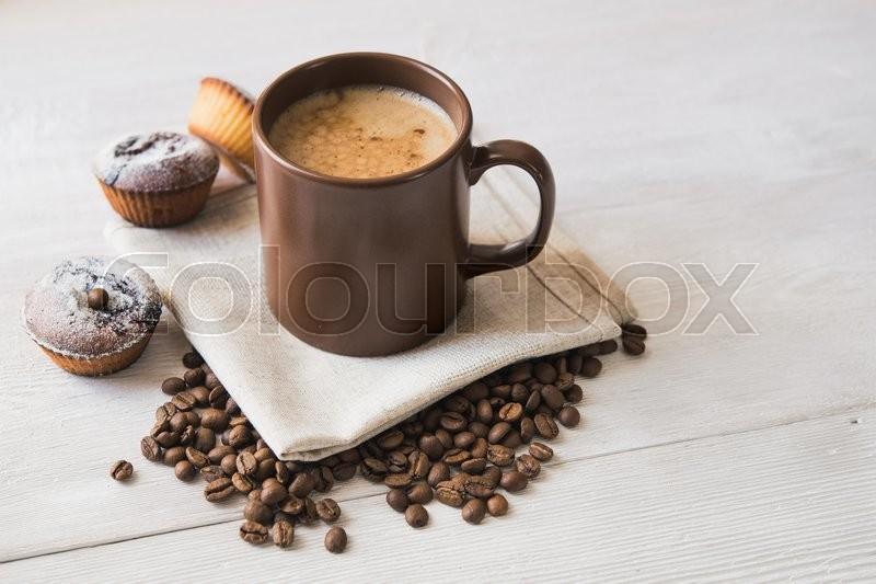 Stock image of 'tasty cup of coffee and cakes on white board'