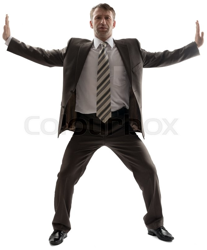 Stock image of 'Business man stretching his arms to sides isolated on white background'