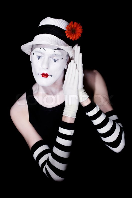 sleep theatrical clown in a white hat and striped gloves on a black background stock photo. Black Bedroom Furniture Sets. Home Design Ideas