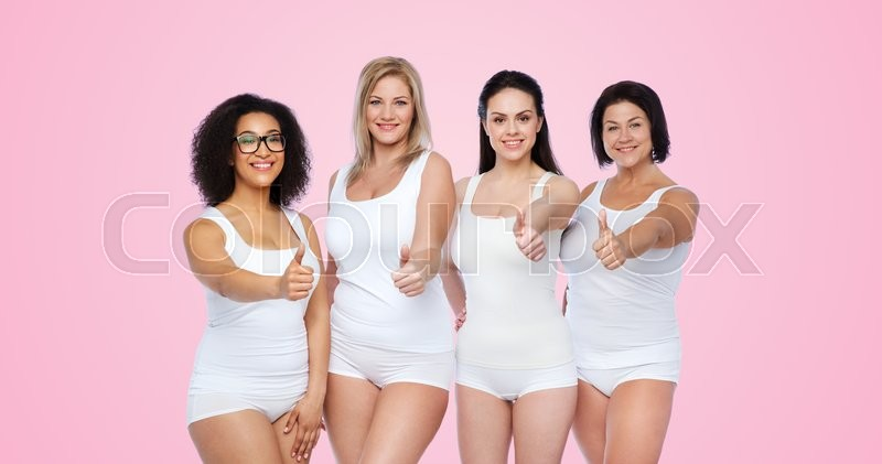 Stock image of 'gesture, friendship, beauty, body positive and people concept - group of happy different women in white underwear showing thumbs up over pink background'