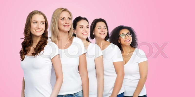 Stock image of 'friendship, diverse, body positive and people concept - group of happy different size women in white t-shirts over pink background'