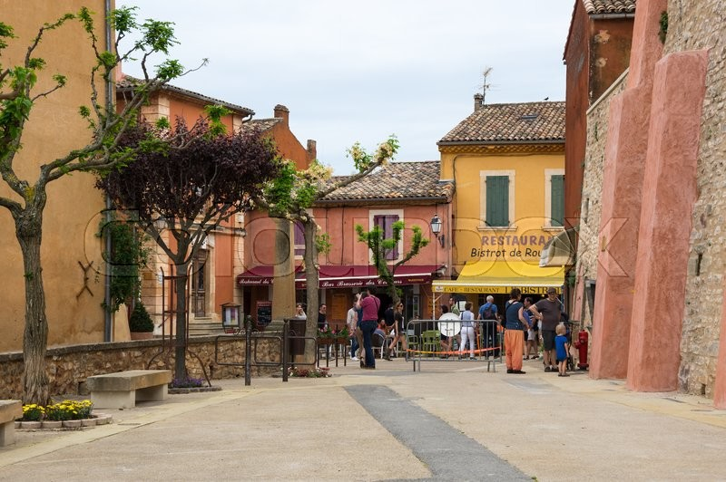 Editorial image of 'ROUSSILLON, FRANCE - MAY 03, 2015: Street of medieval village of Roussillon. It ochre village is included in list of \
